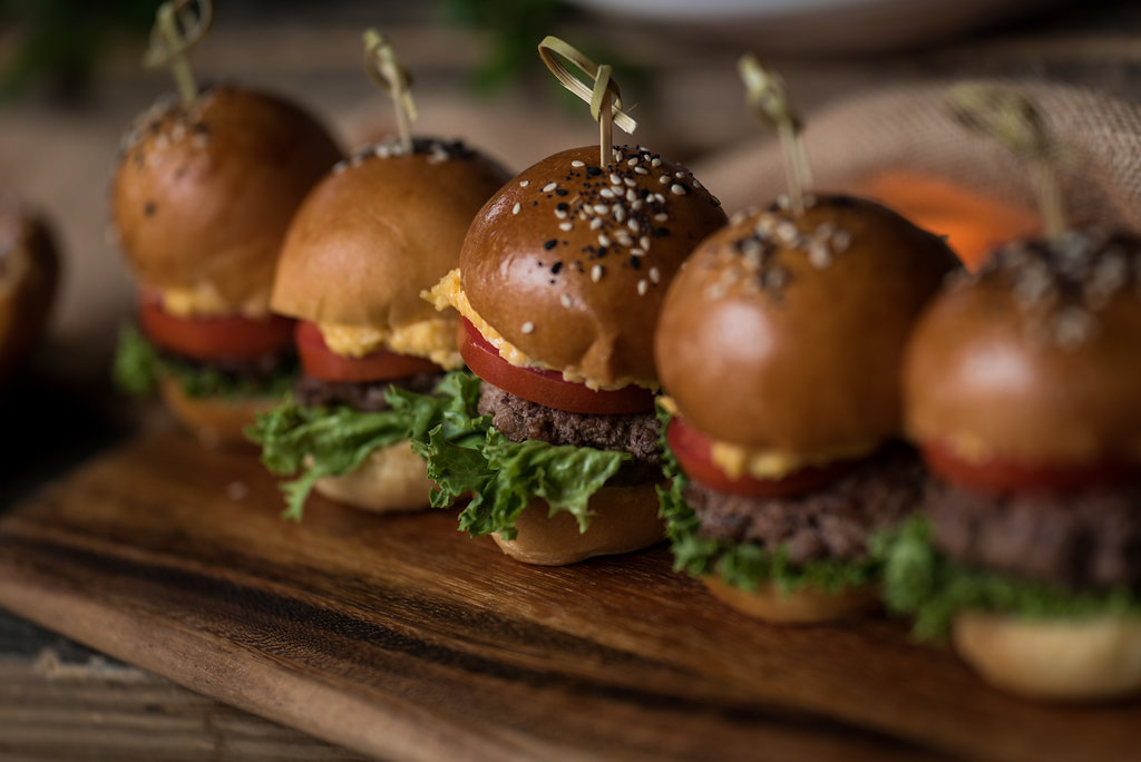 Detail shot of food, Cheeseburger sliders,part of a Boho Brewery Wedding Styled Shoot at Triple C Barrel Room in Charlotte NC. Table,setting, and food provided by Best Impressions Caterers and Party Reflections.