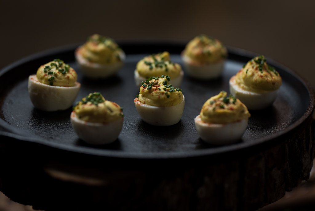 Detail shot of food, deviled eggs,part of a Boho Brewery Wedding Styled Shoot at Triple C Barrel Room in Charlotte NC. Table,setting, and food provided by Best Impressions Caterers and Party Reflections.