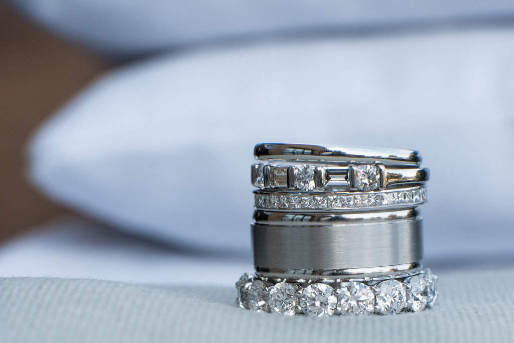 Stack of Rings and Bands at Sugar Creek Brewery Wedding in Charlotte, NC