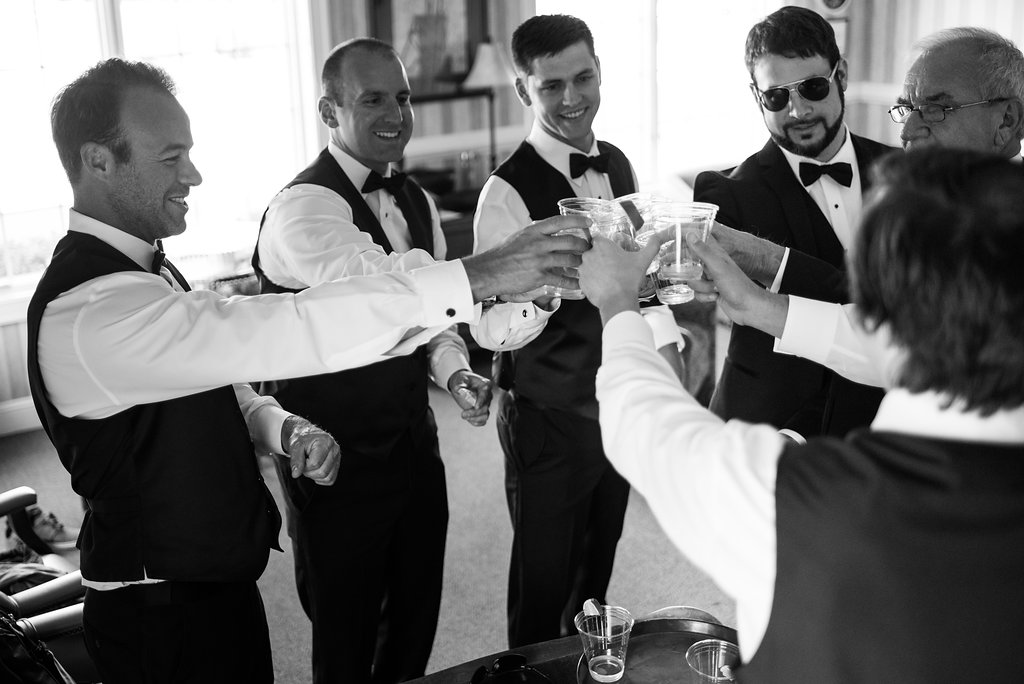 Groom giving toast with tequila shots in Pilot Knob Country Club. Wedding Photography by Party of Two Photography.