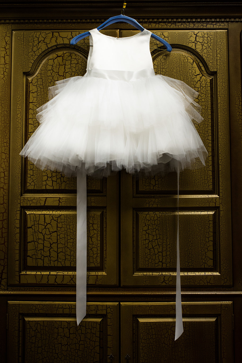 Detail of little girl's dress in Pilot Knob Country Club. Wedding Photography by Party of Two Photography.