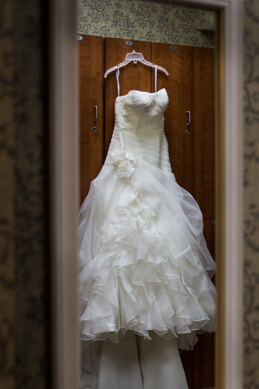 Creative shot of wedding dress in Pilot Knob Country Club. Wedding Photography by Party of Two Photography.