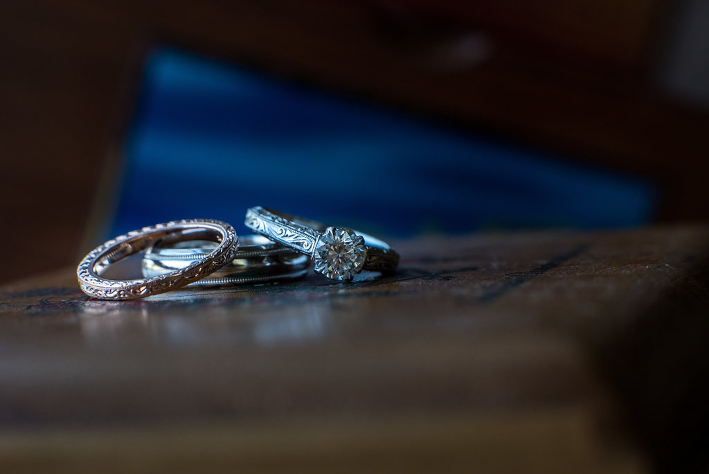 Creative ring shot in Pilot Knob Country Club. Wedding Photography by Party of Two Photography.