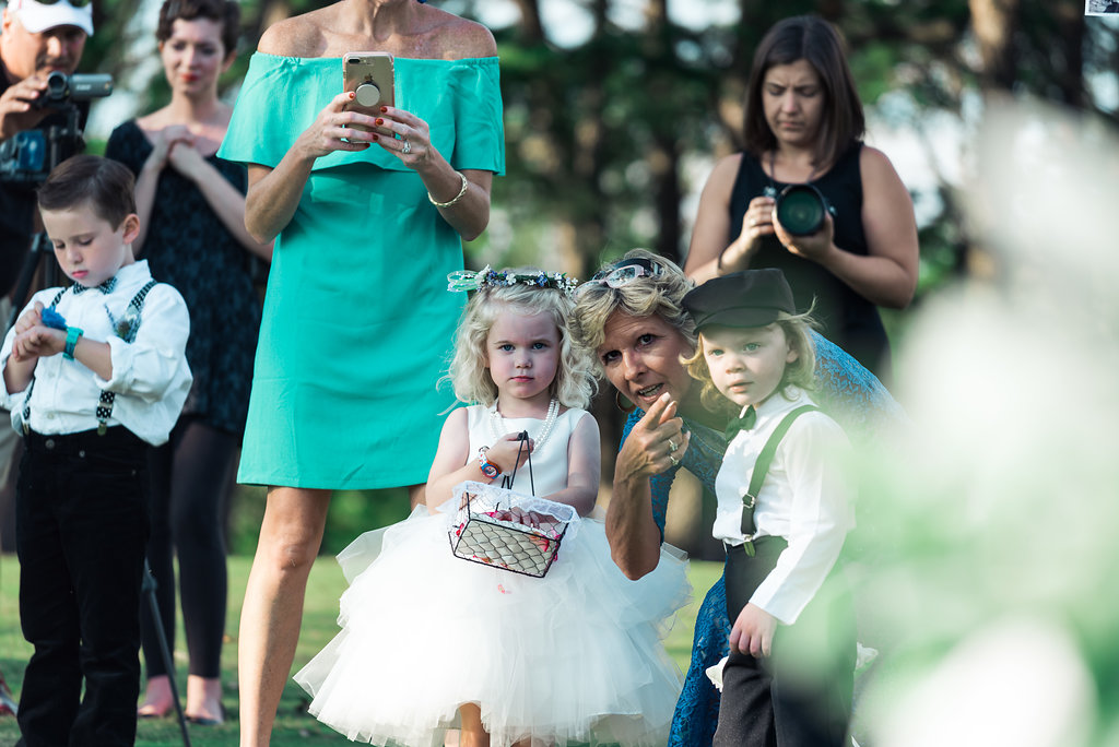 Cute ring bearer and flower girl in Pilot Knob Country Club. Wedding Photography by Party of Two Photography.
