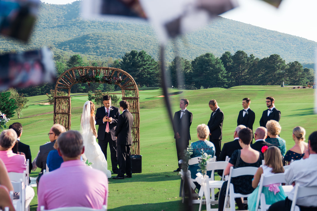 Bride and Groom getting married in Pilot Knob Country Club. Wedding Photography by Party of Two Photography.