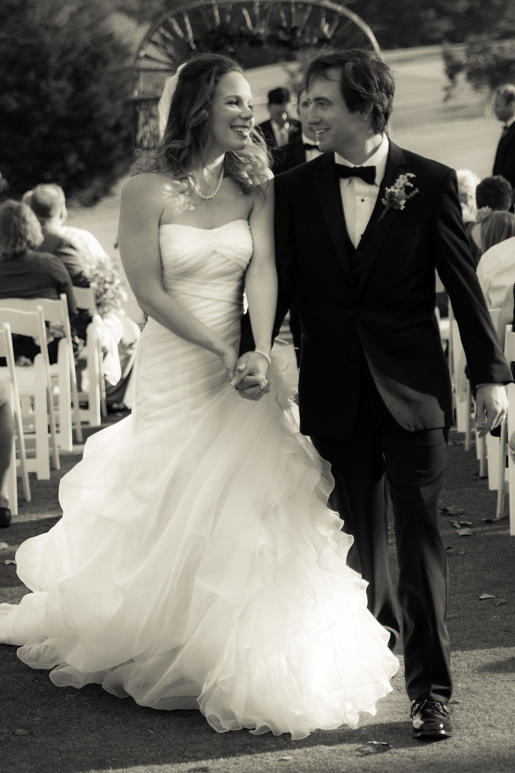 Black and White of Bride and Groom just married at Pilot Knob Country Club. Wedding Photography by Party of Two Photography.