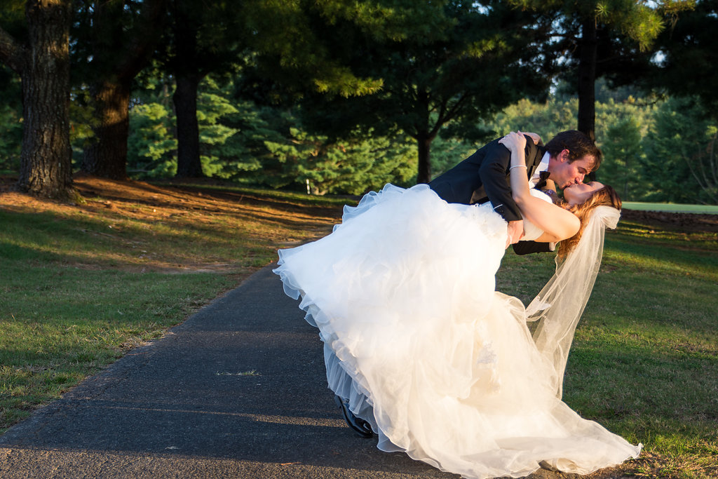 Groom dips Bride for Sunset Portrait at Pilot Knob Country Club. Wedding Photography by Party of Two Photography.