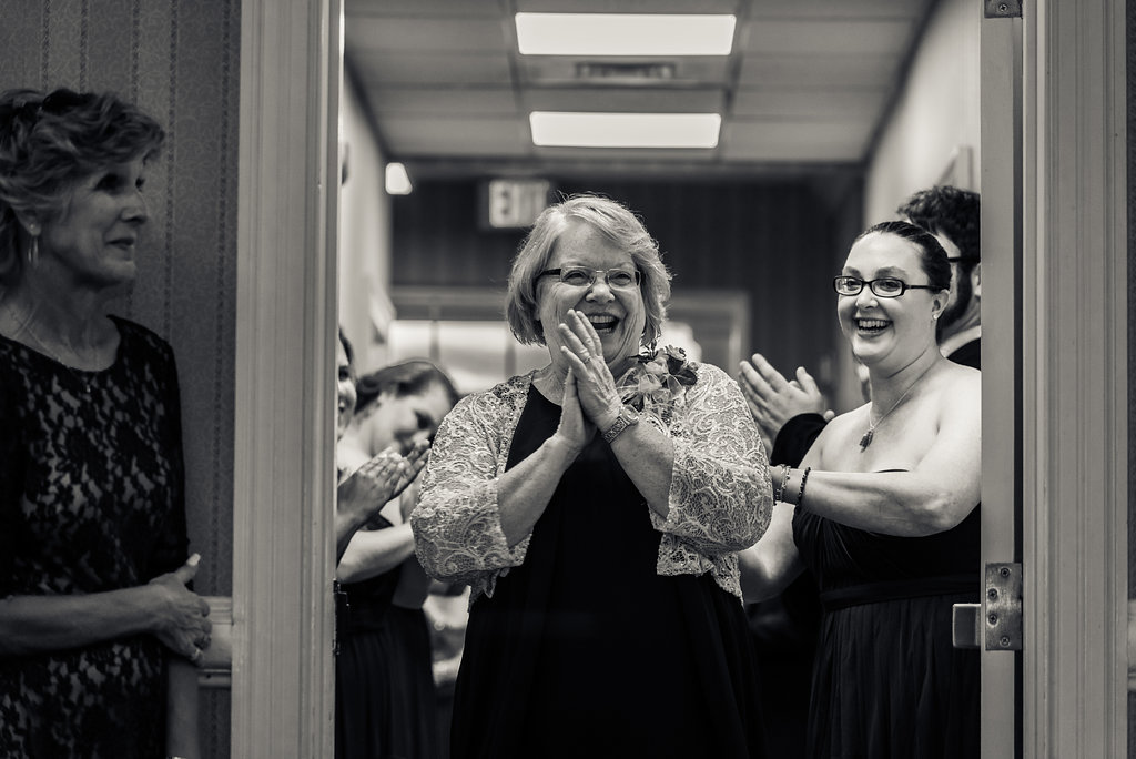 Mom excited to be introduced in Pilot Knob Country Club. Wedding Photography by Party of Two Photography.