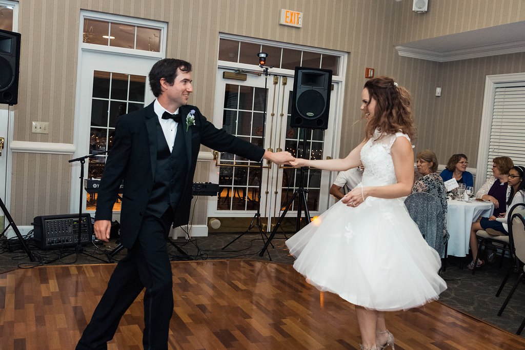 Bride and groom's first dance in Pilot Knob Country Club. Wedding Photography by Party of Two Photography.