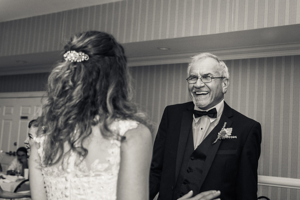 Black and white reception shot of Bride and grandfather dancing in Pilot Knob Country Club. Wedding Photography by Party of Two Photography.