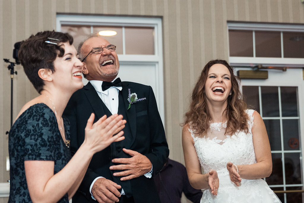 Reception shot of Bride grandfather laughing in Pilot Knob Country Club. Wedding Photography by Party of Two Photography.