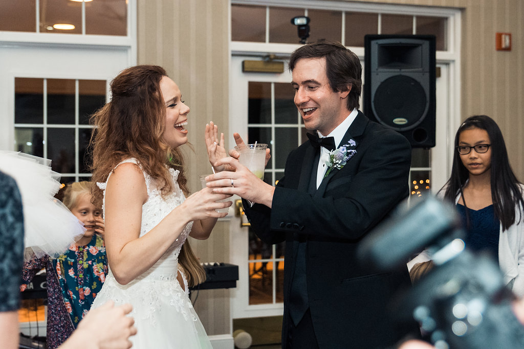 Reception shot of Bride and Groom dancing in Pilot Knob Country Club. Wedding Photography by Party of Two Photography.