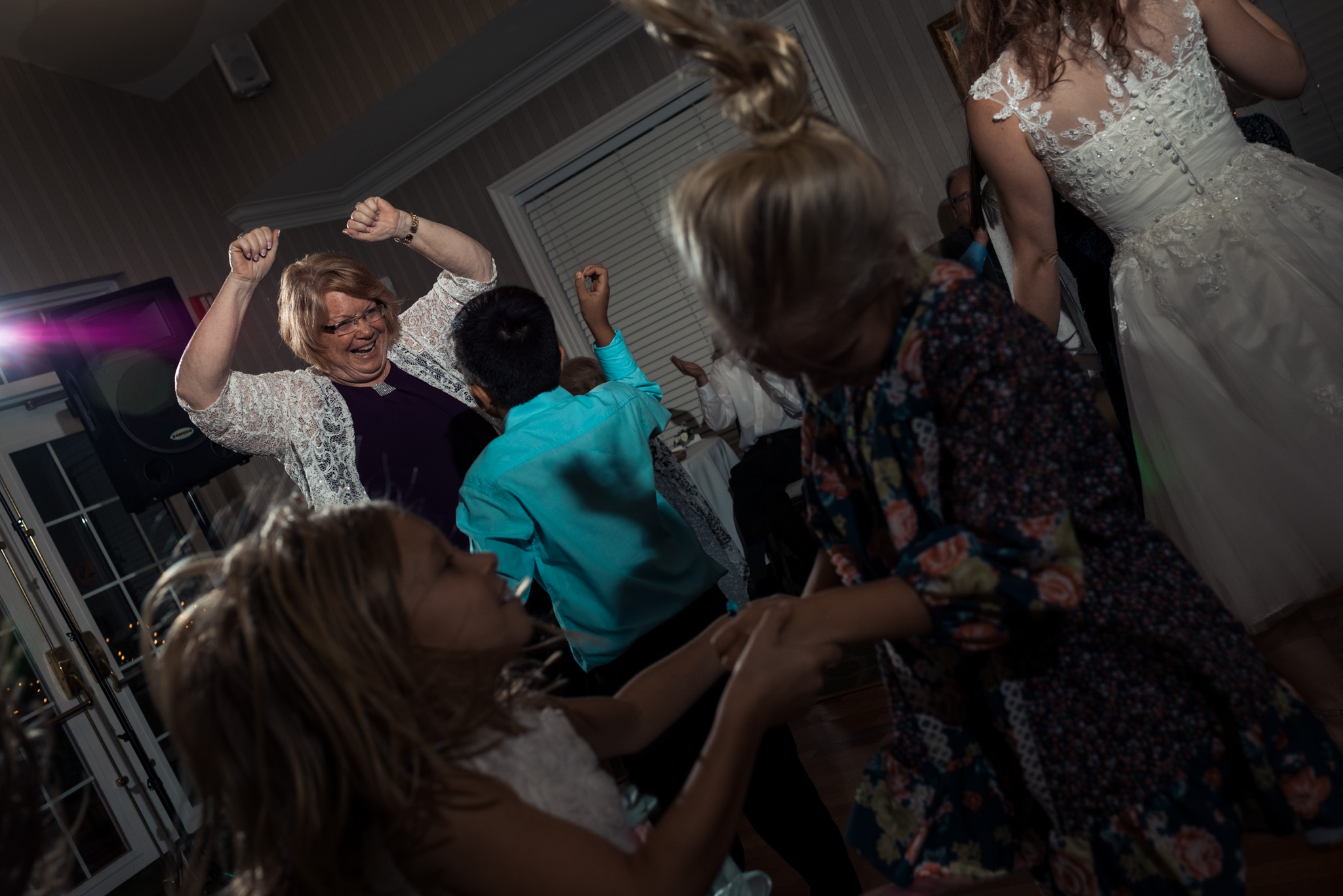Reception shot of mom dancing in Pilot Knob Country Club. Wedding Photography by Party of Two Photography.