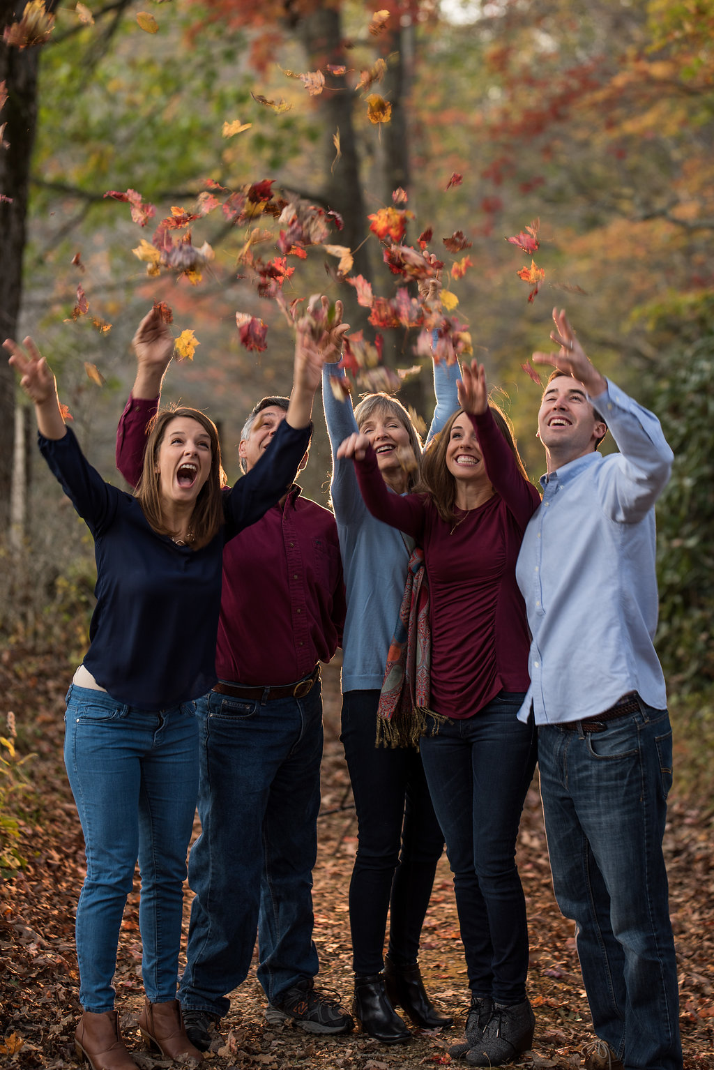 Blue Ridge Mountains NC Fall Fun Family Photo of family Throwing Leaves by Party of Two Photography