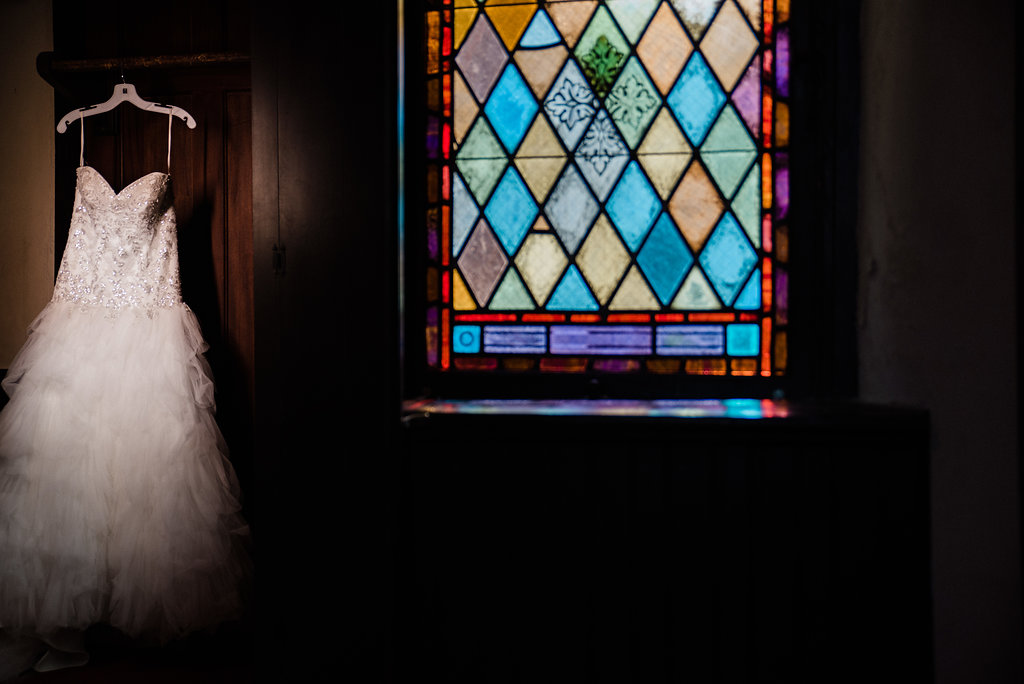 Wedding Dress and Stained Glass at St. Mary's Chapel Wedding in Charlotte NC