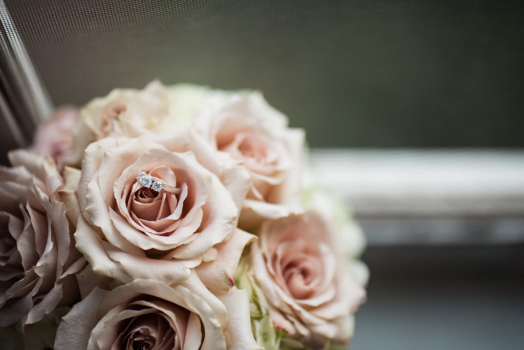 Beautiful Wedding Rings and Flowers at Duke Mansion Reception