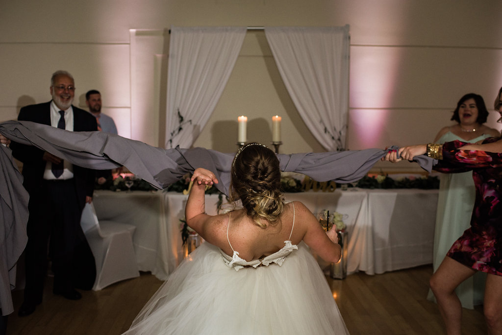 Bride Dancing Limbo at Levine Museum of the New South Reception from Charlotte Wedding Photographer