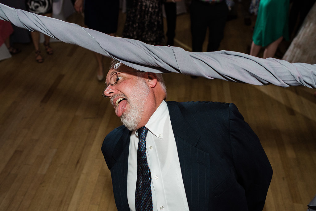 Guest Dancing Limbo at Levine Museum of the New South Reception from Charlotte Wedding Photographer