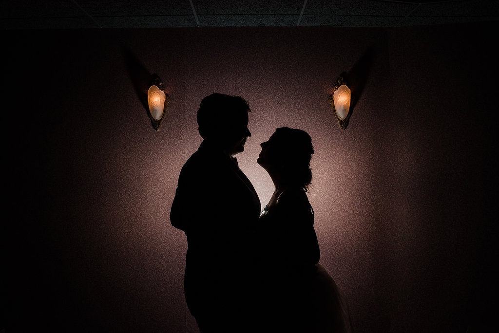 Bride and Groom Silhouette at Levine Museum of the New South Reception from Charlotte Wedding Photographer