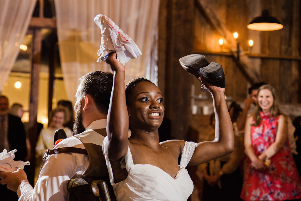 Reception Shoe Game at Summerfield Farms from Charlotte NC Wedding Photographer