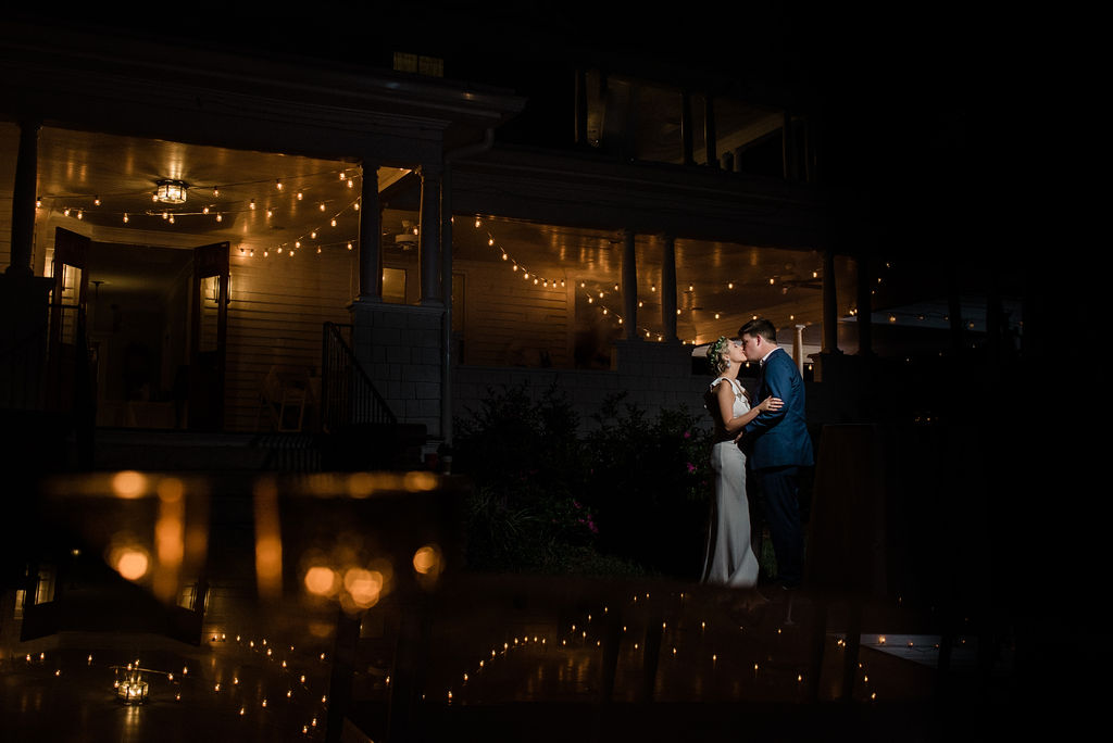 Bride and Groom Night Porch Photo at Ritchie Hill Venue in Concord NC by Charlotte Wedding Photographers