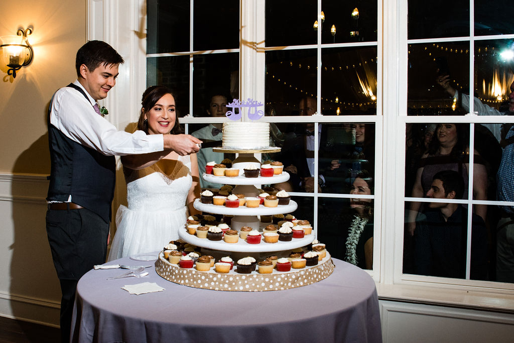Cake Cutting at Reception at Bride at The Oaks at Salem Wedding in Apex, NC by Charlotte Wedding Photographers