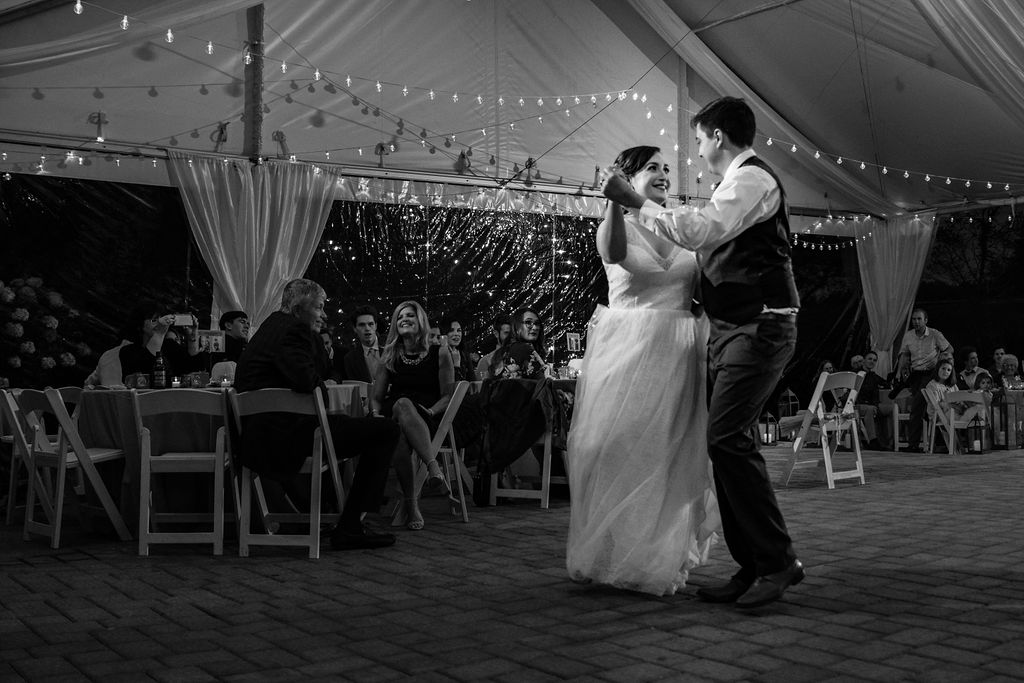 Bride and Groom First Dance at Reception at Bride at The Oaks at Salem Wedding in Apex, NC by Charlotte Wedding Photographers