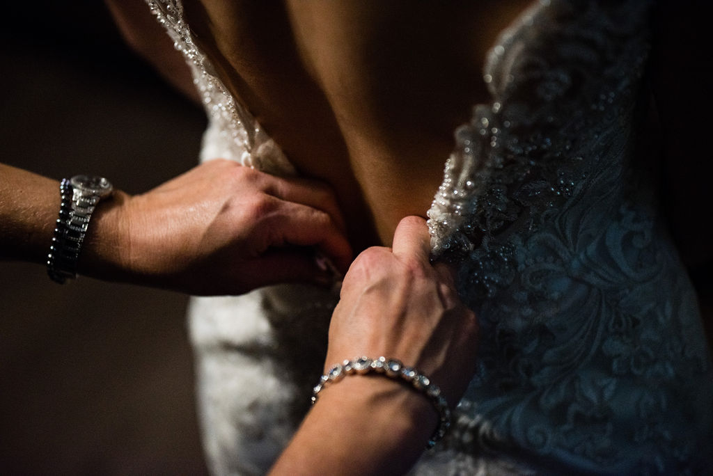 Bride Getting in Dress Details by Charlotte Wedding Photographers