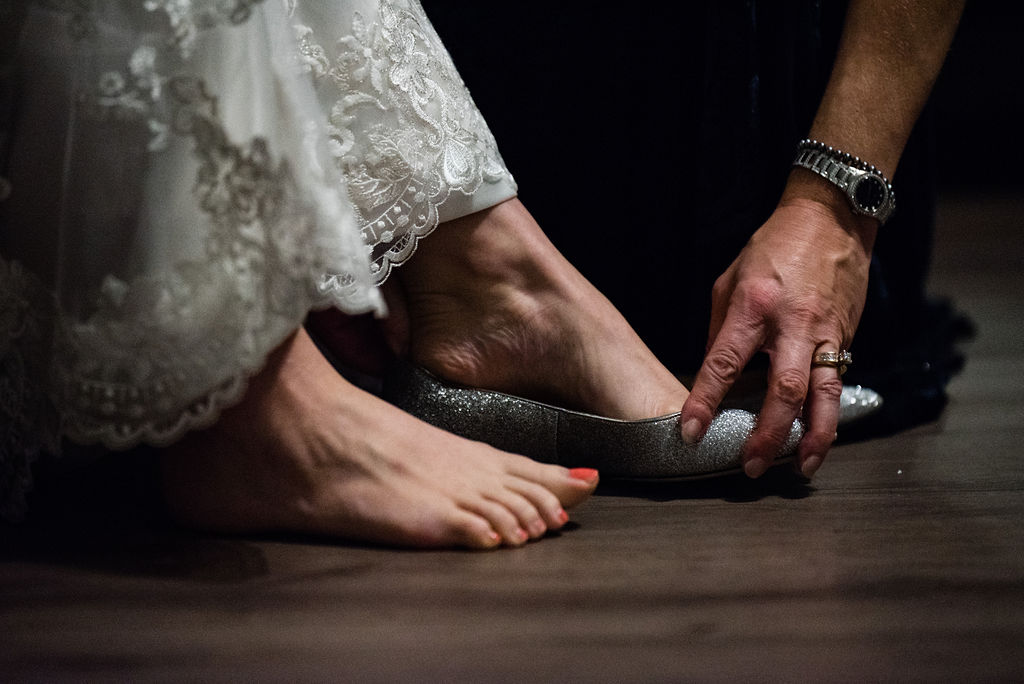 Bride Getting Ready into Shoes by Charlotte Wedding Photographers