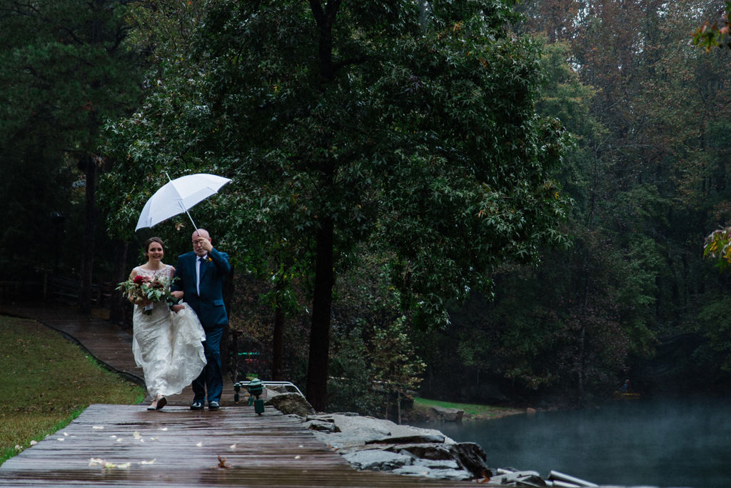 Bride Walking Down Aisle in Ceremony at Quarry at Carrigan Farms by Charlotte Wedding Photographers