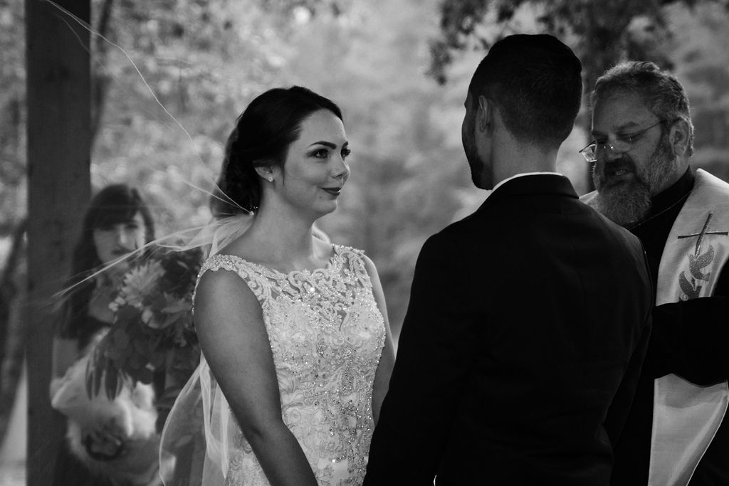 Bride and Groom at Wedding Ceremony at Quarry at Carrigan Farms by Charlotte Wedding Photographers