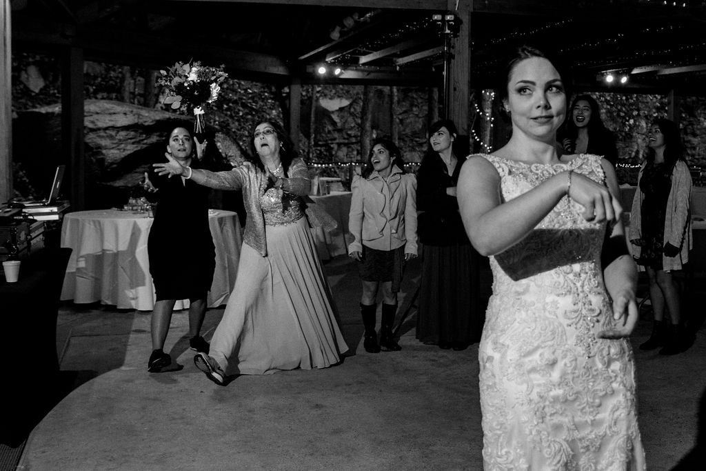Bouquet Toss at Reception at Quarry at Carrigan Farms by Charlotte Wedding Photographers