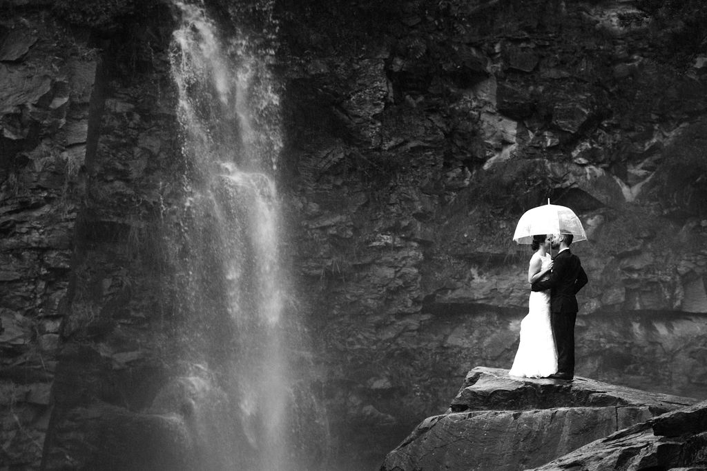 Rainy Day Bride and Groom Umbrella Portrait at Quarry at Carrigan Farms by Charlotte Wedding Photographers