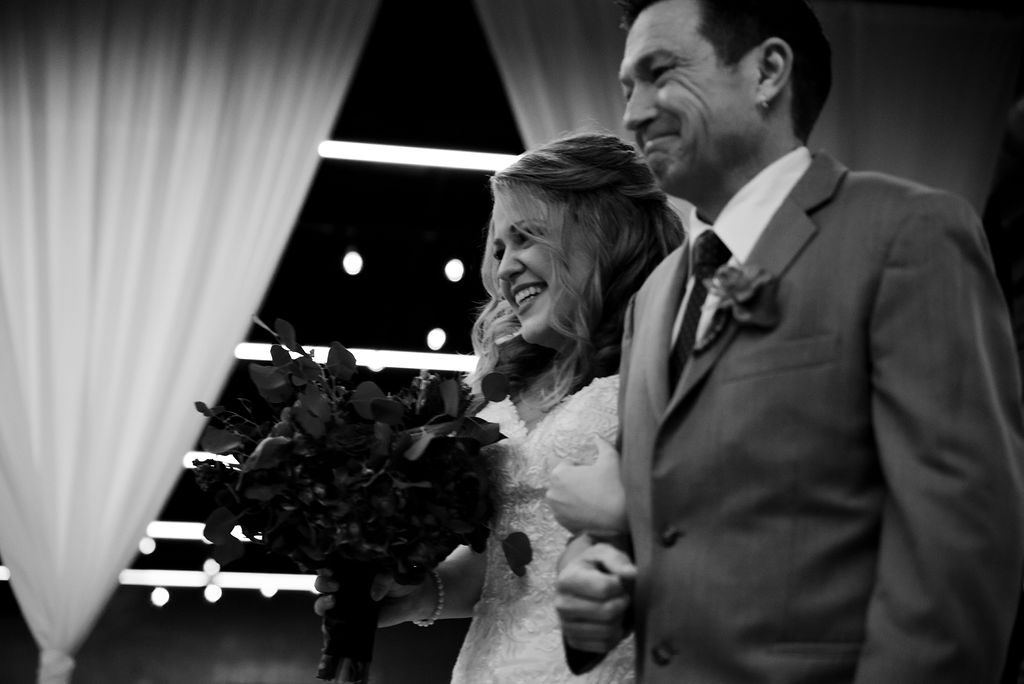 Bride Reaction at Triple C Barrel Room by Charlotte Wedding Photographers