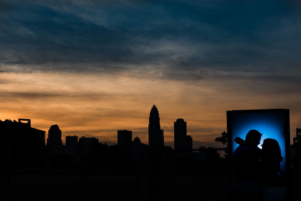 Uptown skyline silhouette at Independence Park Engagement Session by Charlotte Wedding Photographers