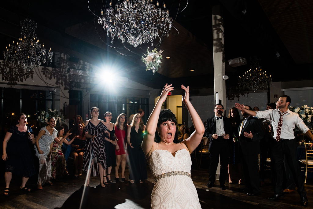 Bouquet toss at Reception at Cedar Hill by Charlotte Wedding Photographers