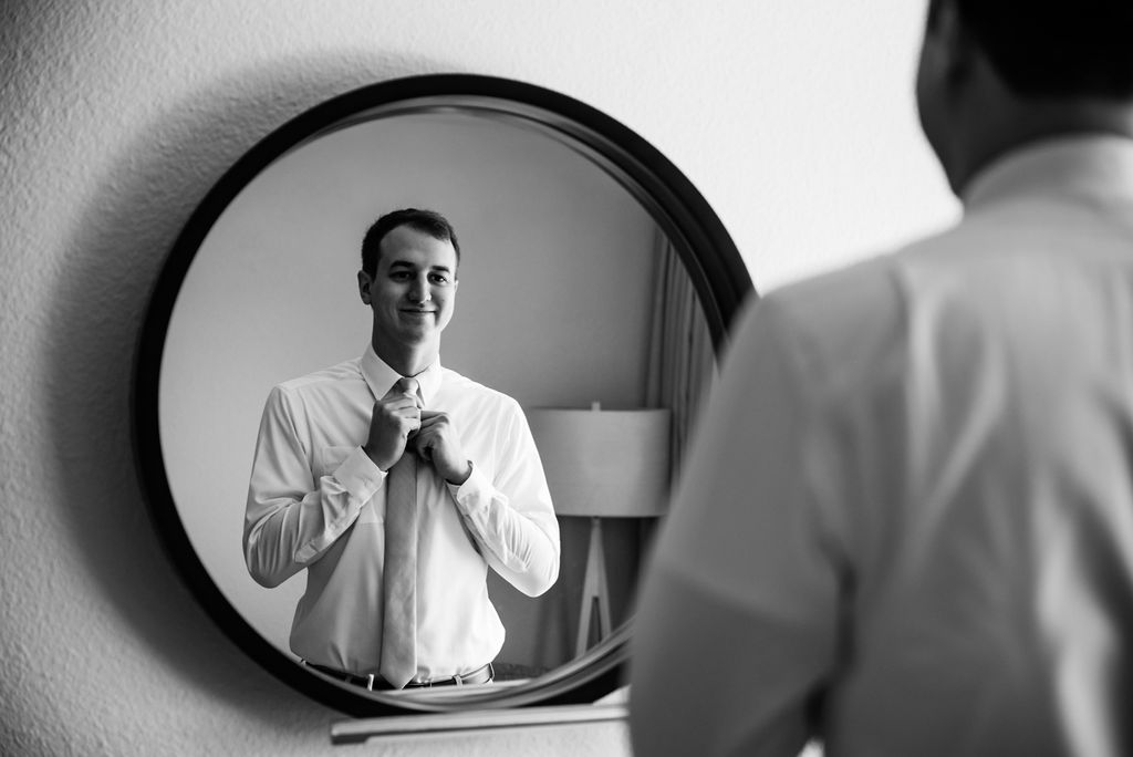 Groom Getting Ready at Hotel Ballast in Wilmington NC by Charlotte Wedding Photographers