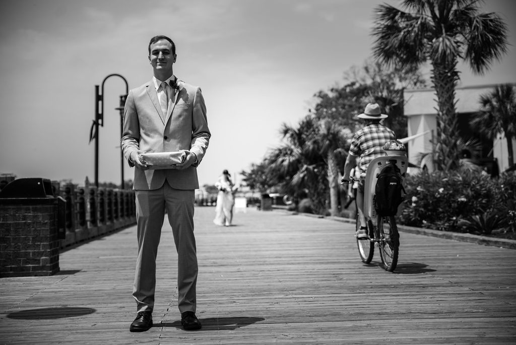 First Look on Boardwalk at Hotel Ballast in Wilmington NC by Charlotte Wedding Photographers