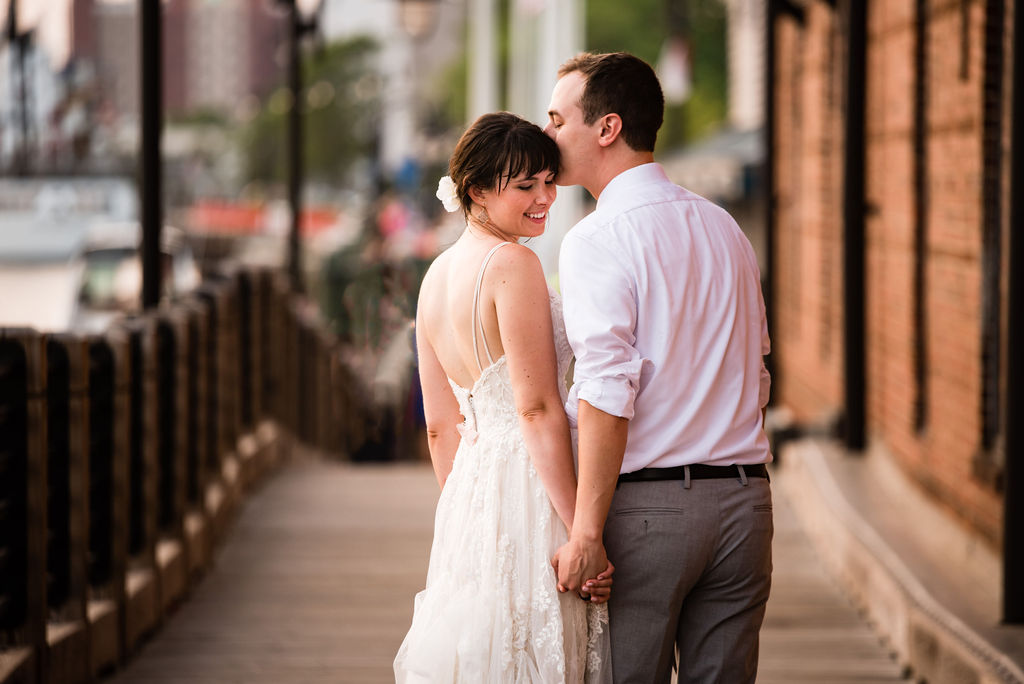 Bride and Groom Portraits on Boardwalk in Wilmington NC by Charlotte Wedding Photographers