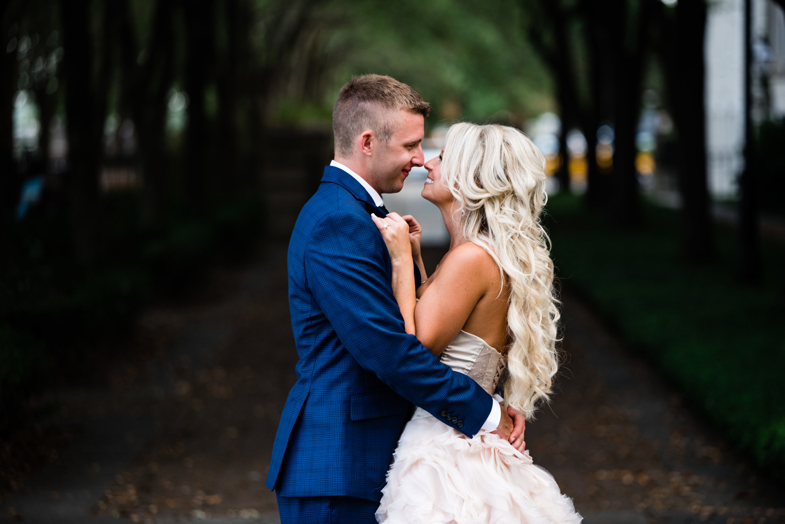 Bride and Groom Portraits at the Waterfront Park in Charleston by Charlotte Wedding Photographers