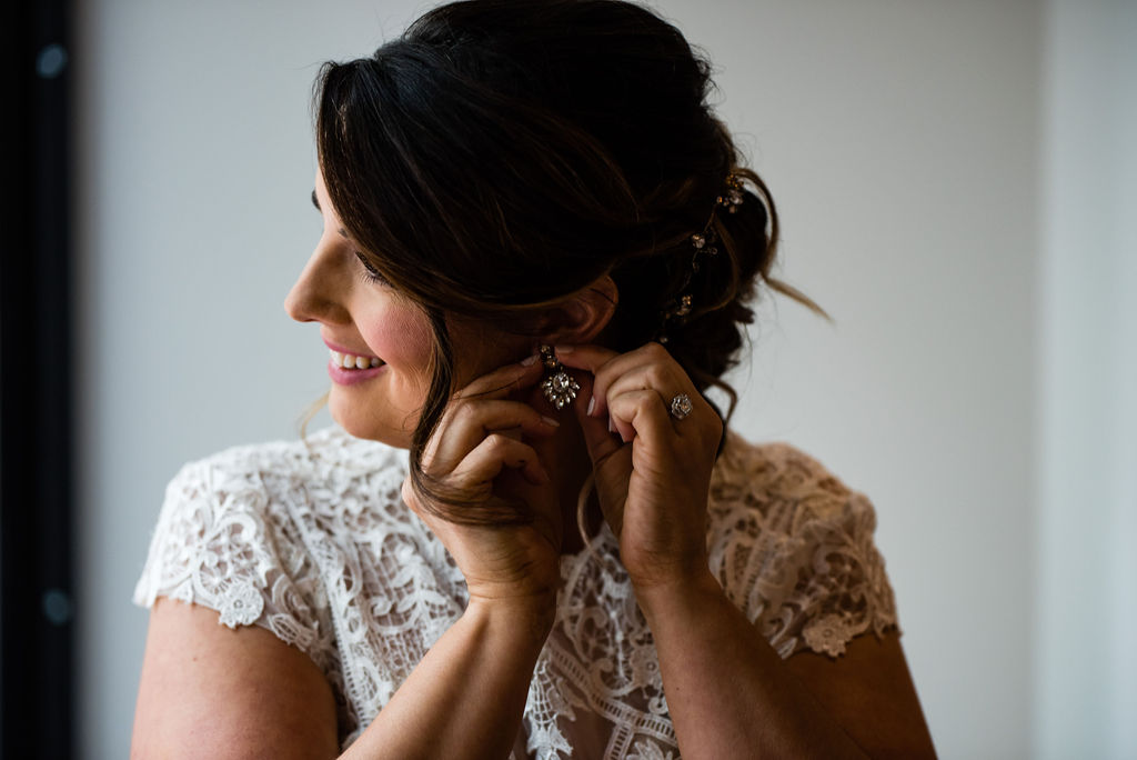 Bride Getting Ready at the Ivey's Hotel by Charlotte Wedding Photographers