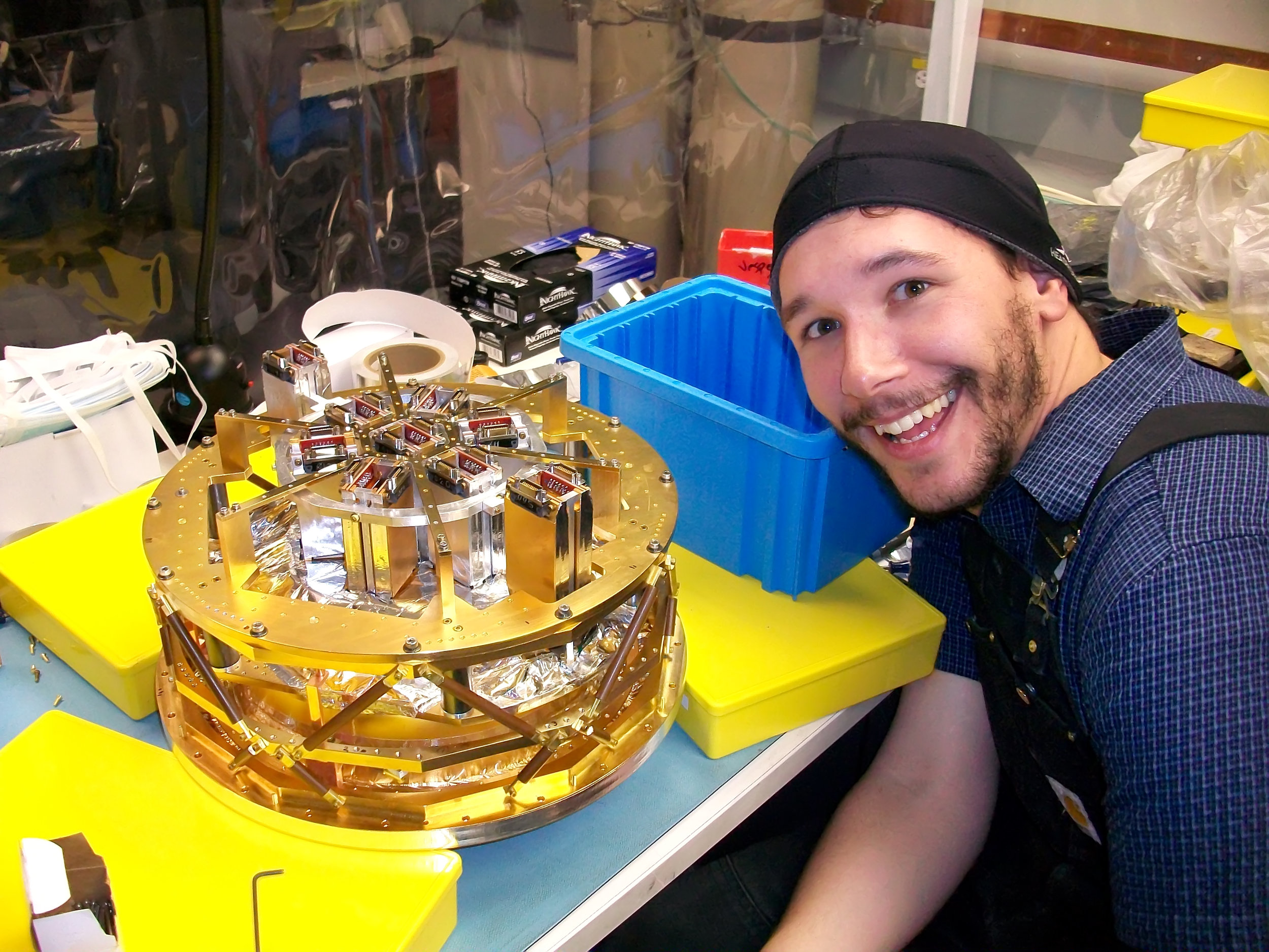 Me and the back side of the SPTpol focal plane. Credit: Bradford Benson.