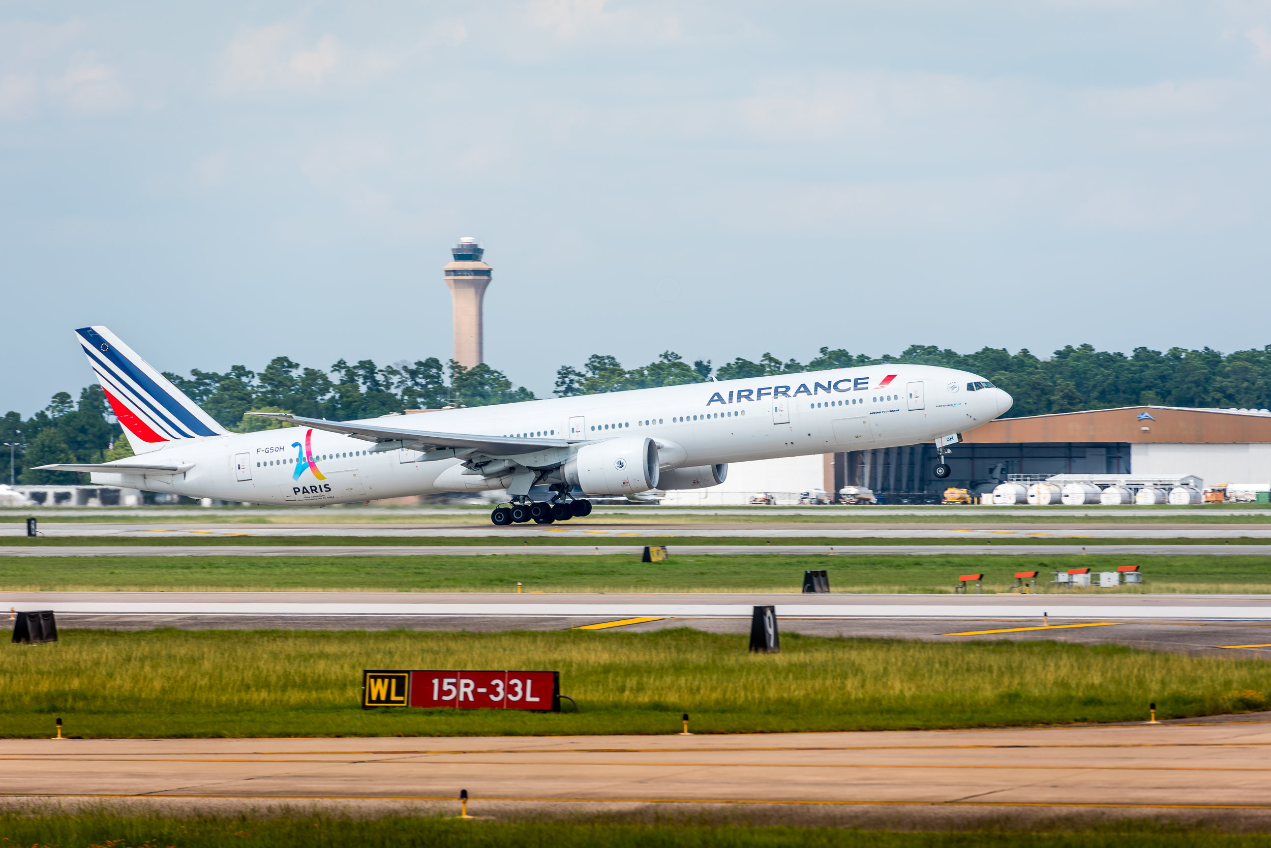 Air France 777-300ER with the control tower keeping a watchful eye