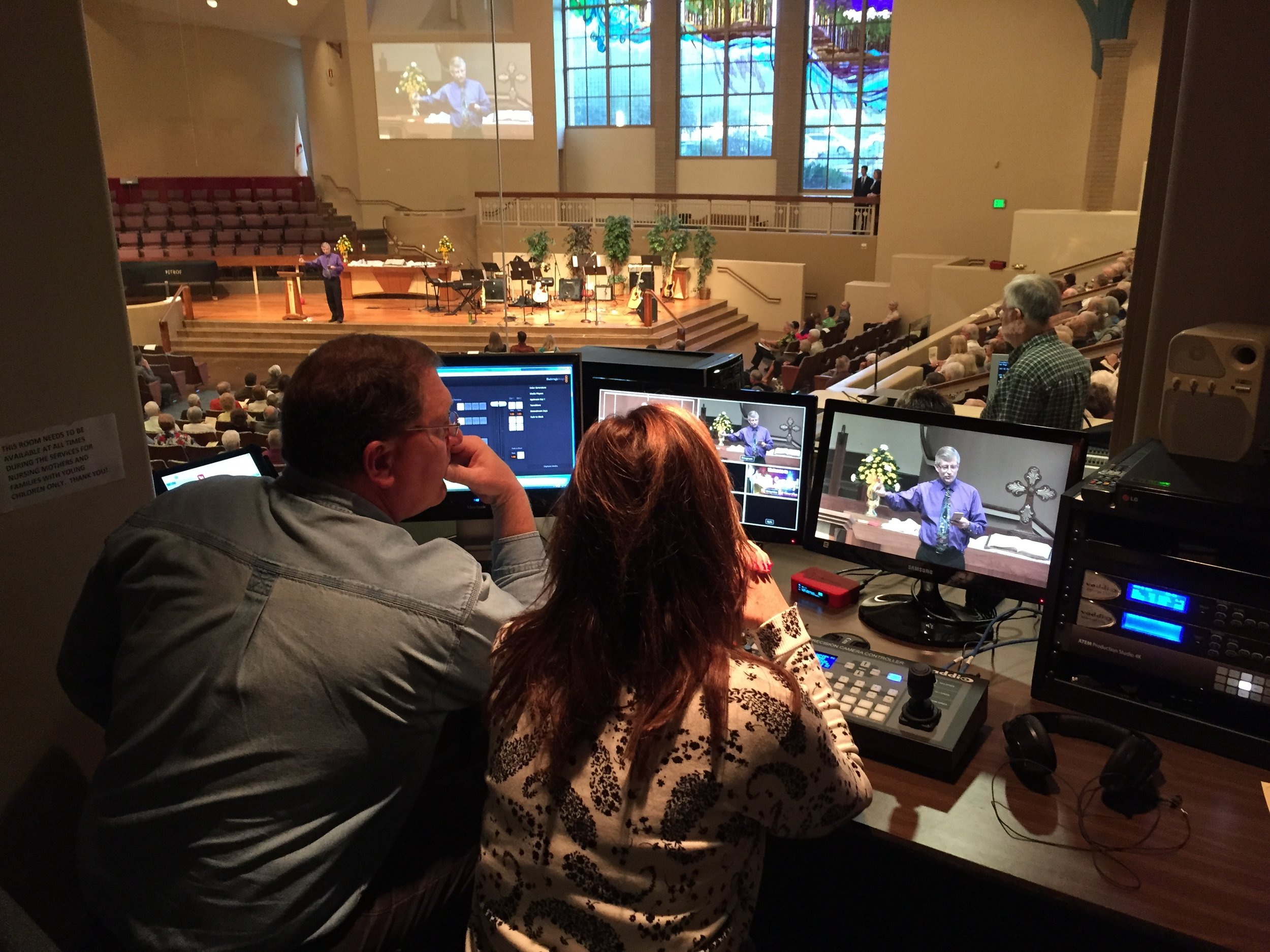 Volunteer staff running video broadcast suite by Blackmagic Design streaming each weekend to Live Stream.