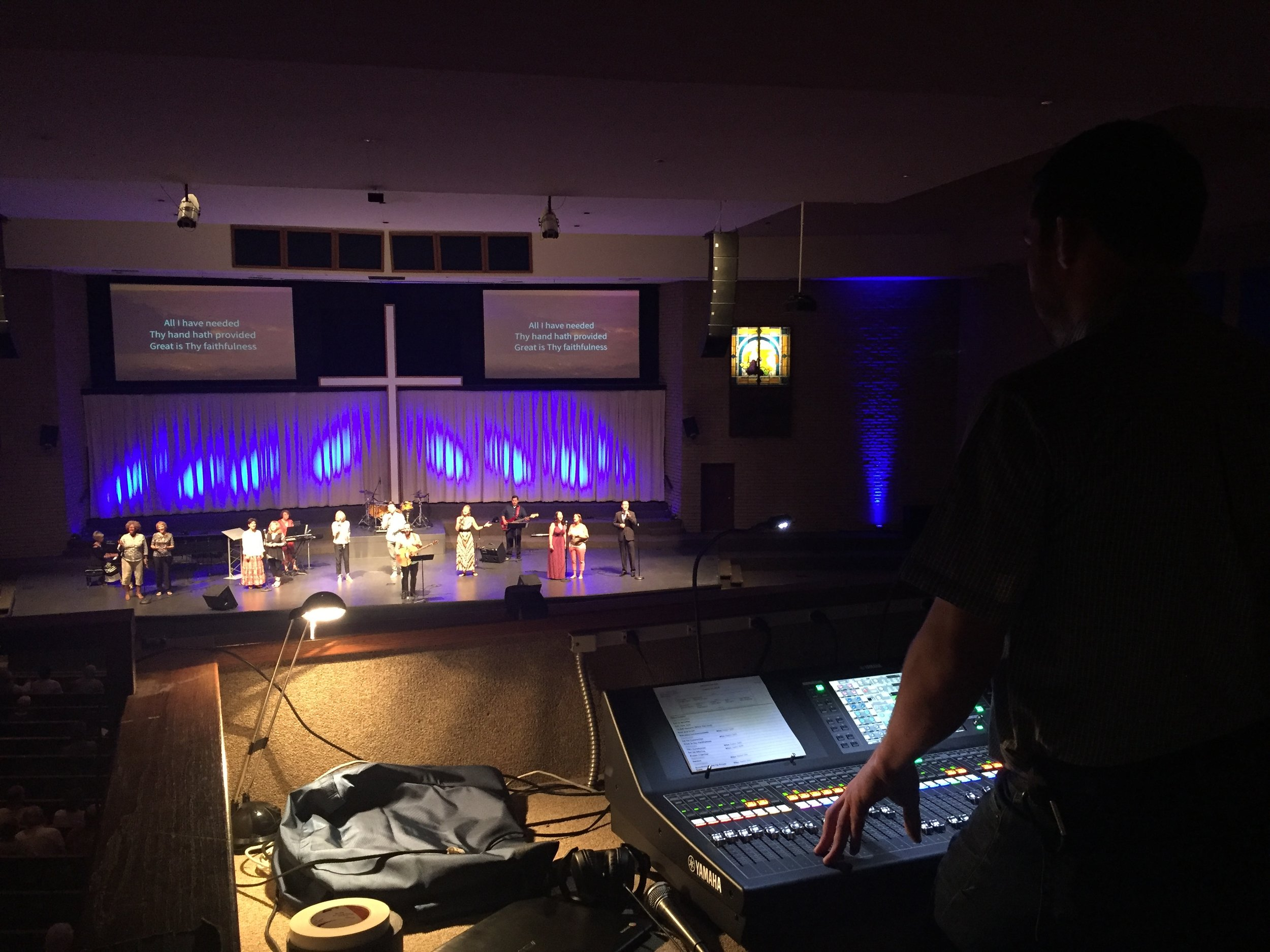 GCC staff running a Yamaha QL5 console to drive the Electro-Voice EVA line-array system.