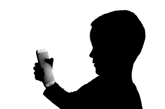child-holding-smart-phone.jpg