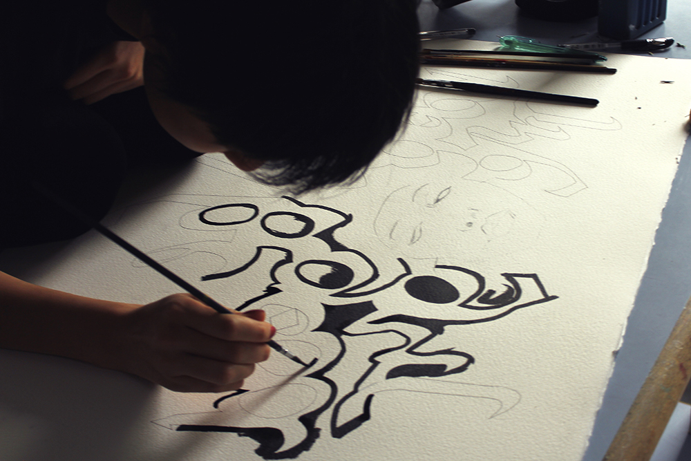 Working on a calligraphic piece   in high school, 2012.