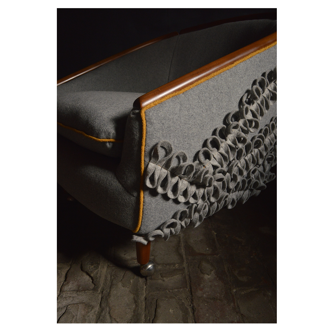 The edges are piped in a luxurious Bute fabric which compliments the thread used to attach the felt washers.