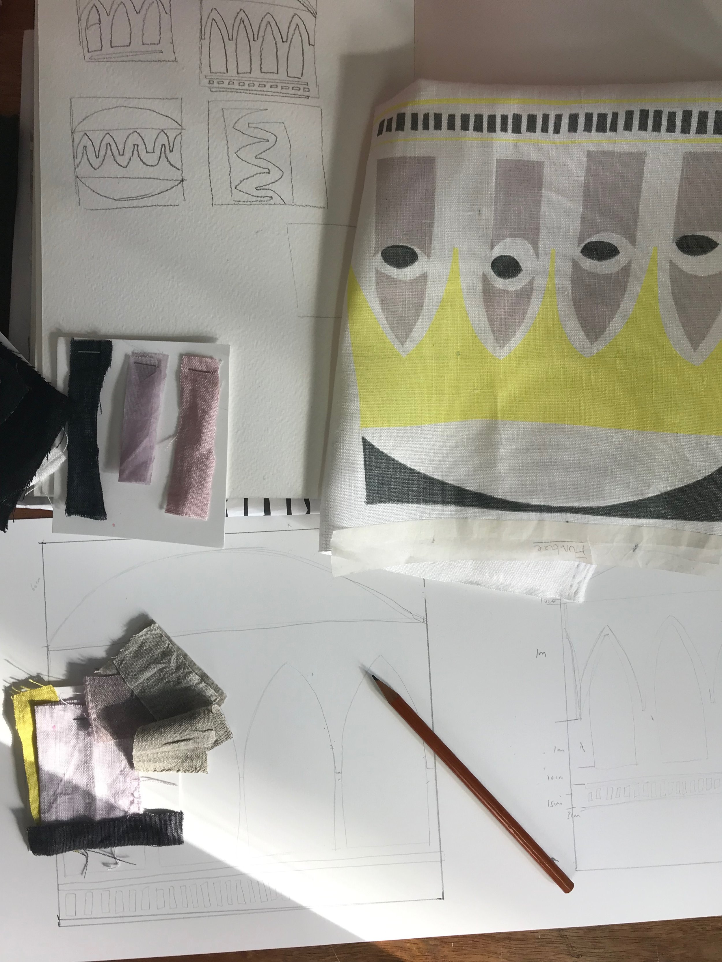 The beginning of the design process, a screen printed sample, a scale drawing and a few fabric swatches.