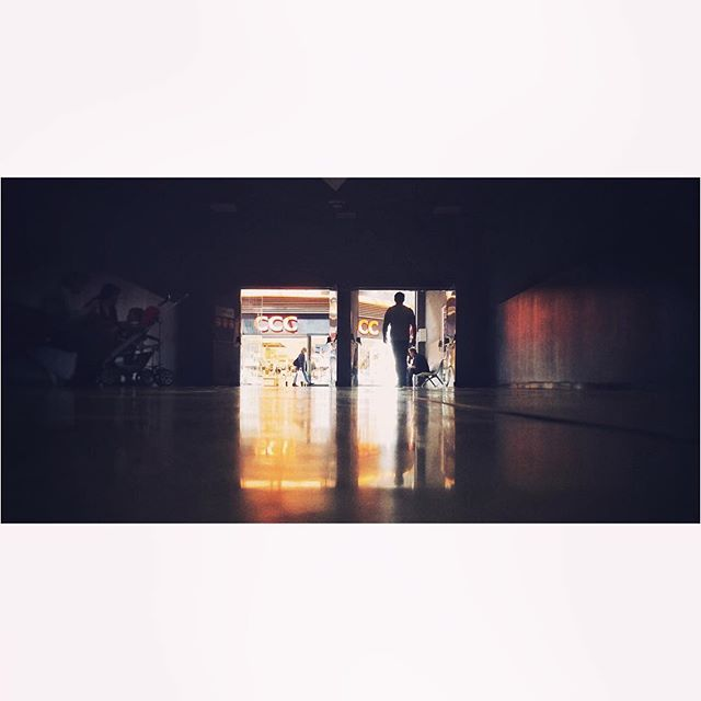 In and out #hall #dark #light #contrast #colorfull #cinematography #nocrop #tbt #photooftheday #picoftheday #reflection #people #silhouette #spotless #shining